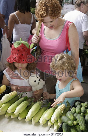 Little Rock Arkansas River Market Farmers Market buyers sellers locally grown produce woman girls family hat stuffed - Stock Image