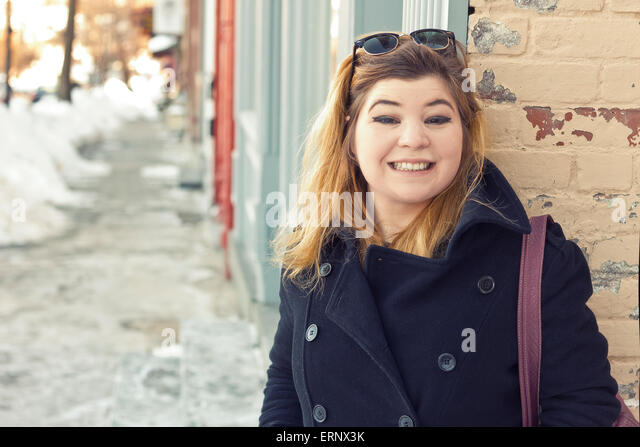 Friendly girl early 20s on location going about her everyday life - Stock-Bilder