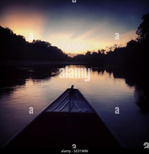 Canoe at dusk, Rupununi River, Guyana, South America - Stock-Bilder