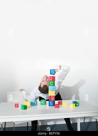 Business man bends over backwards - Stock Image