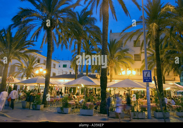 Spain Baleares island Ibiza town by night restaurants near harbour street cafes - Stock Image