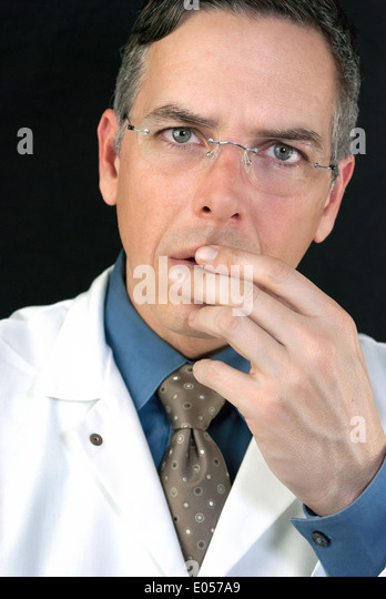 Close-up of a concerned Doctor. - Stock Image
