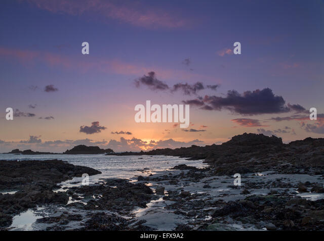 Sunset on guernsey Channel Islands UK - Stock Image