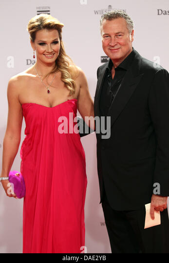 Former German swimming star Franziska van Almsick and her husband Juergen Harder  arrive for the Bambi award in - Stock Image