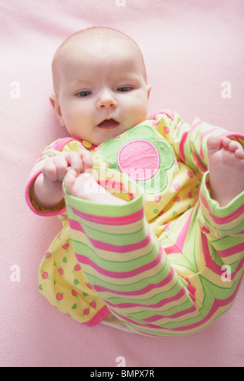 Knoxville, Tennessee, United States Of America; A Baby Girl Playing With Her Toes - Stock Image