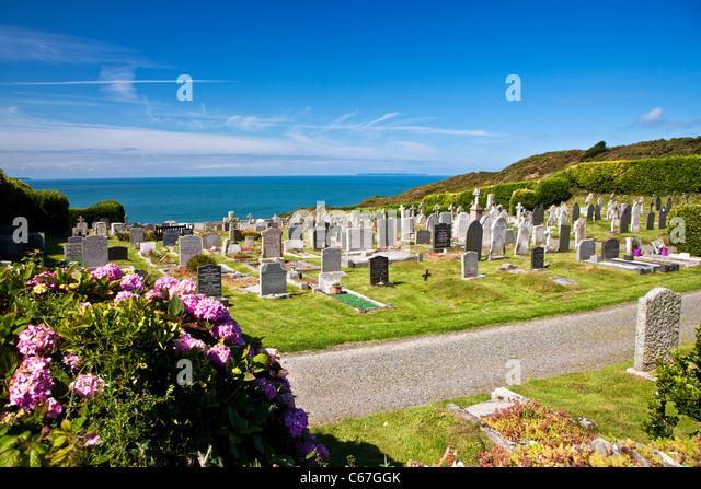 Cemetery at Morthoe overlooking Bristol Channel and Lundy Island, near Woolacombe, north Devon, England, UK - Stock Image