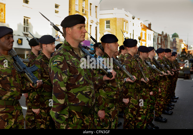 Royal Yeomanry troops standing to attention during a parade through Hammersmith - Stock Image