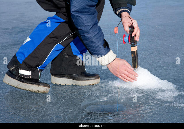 Ice fishing sweden stock photos ice fishing sweden stock for Frozen fishing pole