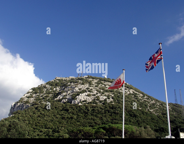 The British Union Flag (Union Jack) flies proudly alongside the Gibraltar Key and Castle Flag, Gibraltar, Europe, - Stock Image