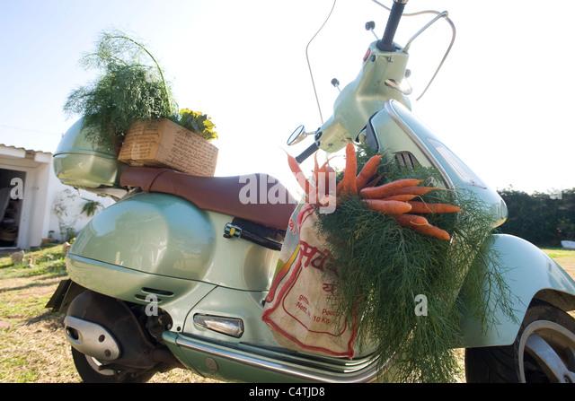 Fresh produce on motor scooter - Stock Image