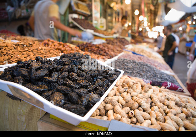 Merchant is selling dried fruits and nuts at Tetouan souk. Morocco - Stock Image