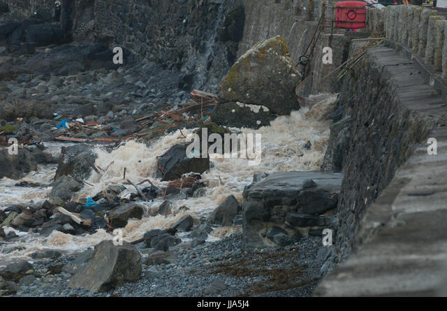 Coverack, Cornwall. 18th July 2017. Flash flood in coastal village of Coverack washes debris from the town onto - Stock Image
