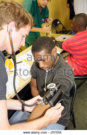 Miami Florida Liberty City Jessie Trice Community Health Center fair free care exam volunteer vital sign blood pressure - Stock Image