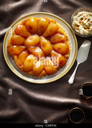 Plate of baked pear tart - Stock Image