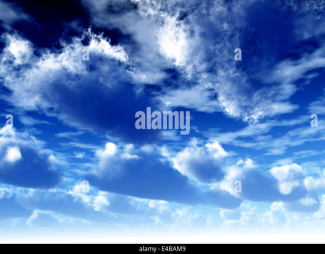 cumulus clouds soaring on the dark blue sky - Stock Image