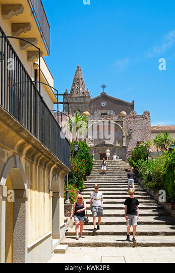 tourists in the mountain village of forza d'agro near messina on the island of sicily, italy. - Stock Image
