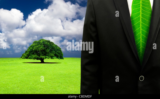 green business concept.Businessman with leaf tie and old tree background - Stock-Bilder