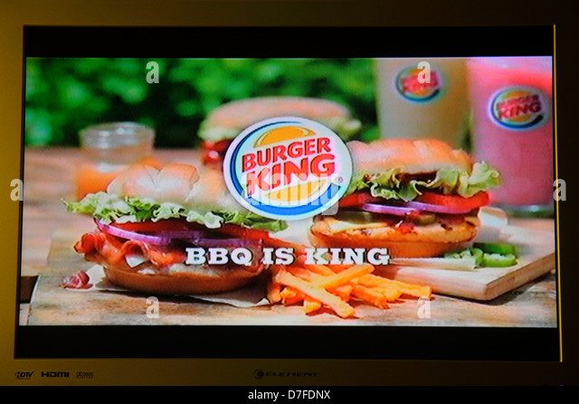 Miami Beach Florida television TV flat screen monitor Burger King ad advertising commercial fast food BBQ - Stock Image