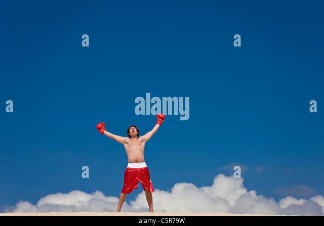 A boxer celebrates on cloud nine. - Stock-Bilder