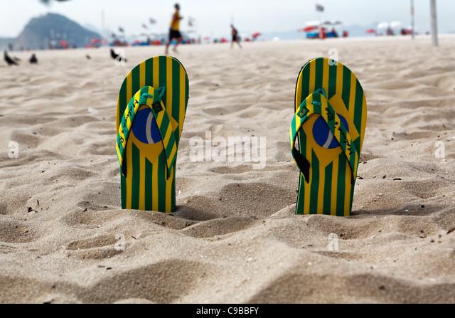 Flip-Flops on Copacabana Beach, Rio de Janeiro, Brazil - Stock Image