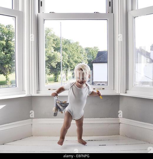 Young boy dancing at home - Stock-Bilder