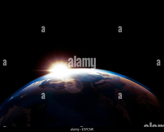 Earth globe outline lit by the rising Sun isolated on black background - Stock Image