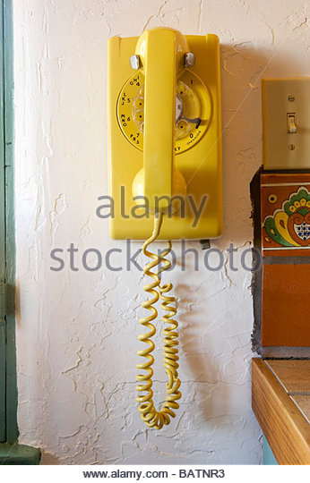 Old-fashioned yellow Rotary Telephone - Stock Image