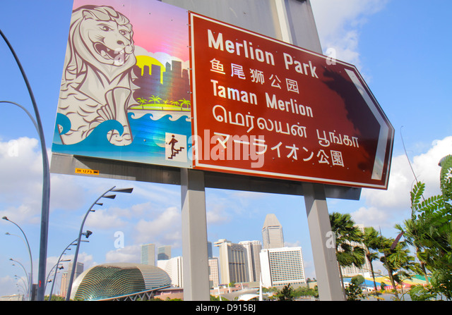 Singapore Esplanade Drive sign information Merlion Park hanzi kanji Esplanade Theatres on the Bay theatre theater - Stock Image