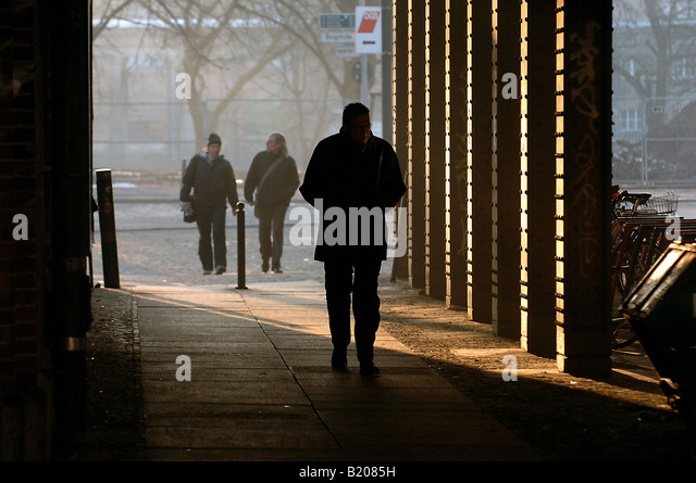 Man walking under a bridge, Berlin, Germany - Stock Image
