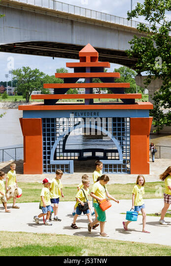 Little Rock Arkansas Breckling Riverfront Park Arkansas River woman teacher boy girl schoolchildren field trip walkway - Stock Image