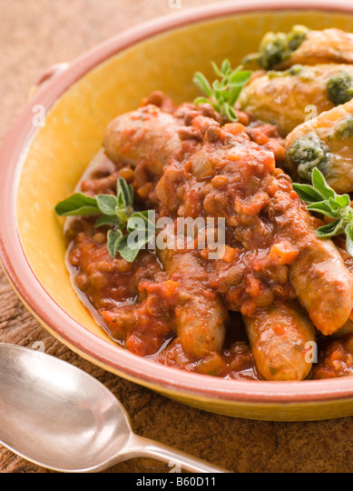 Sausage and Lentil Stew with Pesto Roasted Potatoes - Stock Image
