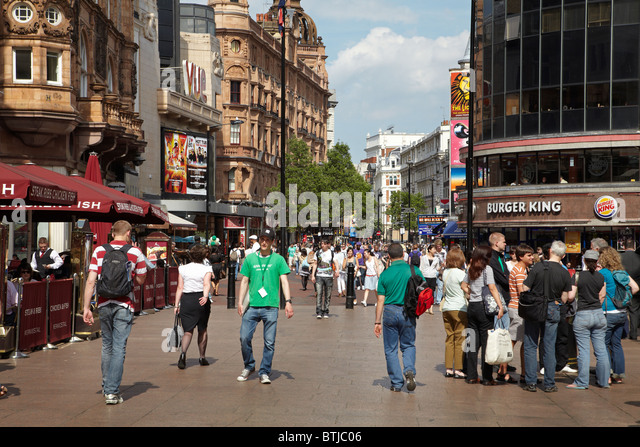 Tourists, Leicester Square, London, England, United Kingdom - Stock Image