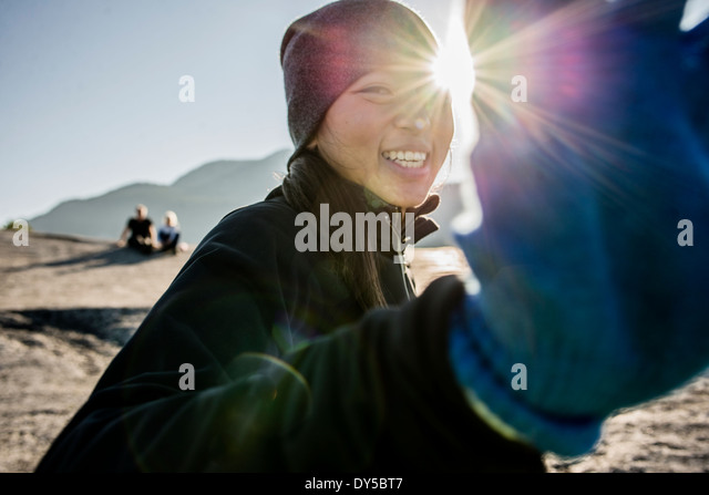Portrait of shy young female hiker, Squamish, British Columbia, Canada - Stock Image