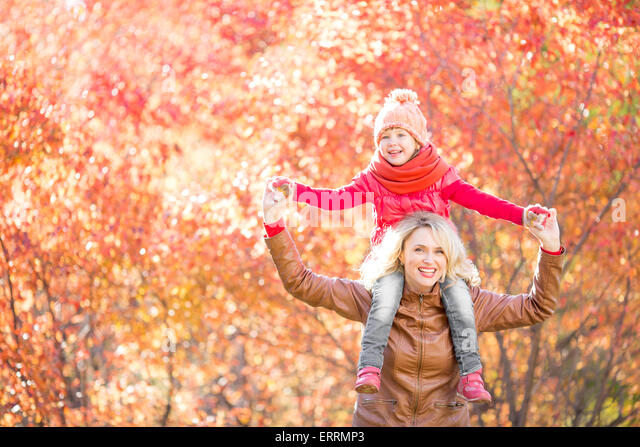Happy family walking in fall - Stock-Bilder
