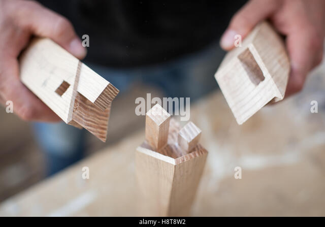 Close up detail of a furniture maker displaying his intricate joinery - Stock-Bilder