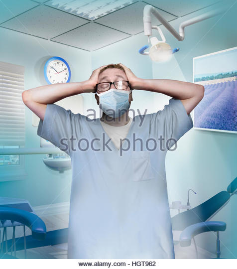 Stressed dentist in despair - Stock-Bilder