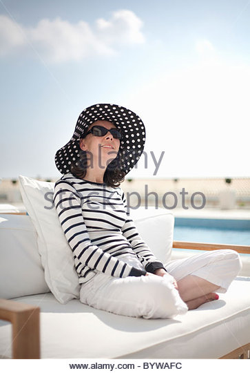Woman relaxing in sunshine - Stock Image