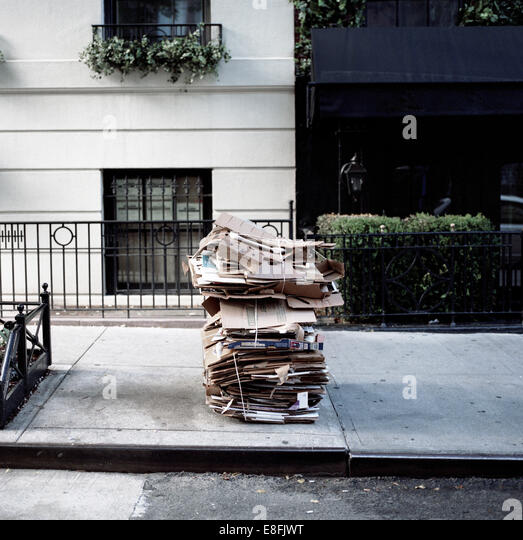 Cardboard boxes on street for recycling, New York, America, USA - Stock Image