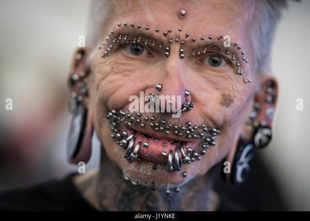 Frankfurt, Germany. 22nd Apr, 2017. dpatop - Rolf Buchholz from Dortmund, wearing more than 450 piercings, can be - Stock-Bilder