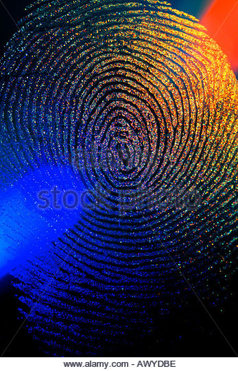 Close up of finger print showing the oil residue left on the surface of a glass being scanned with reader. - Stock Image