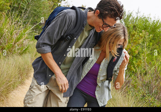 Couple enjoying walk in forest - Stock Image