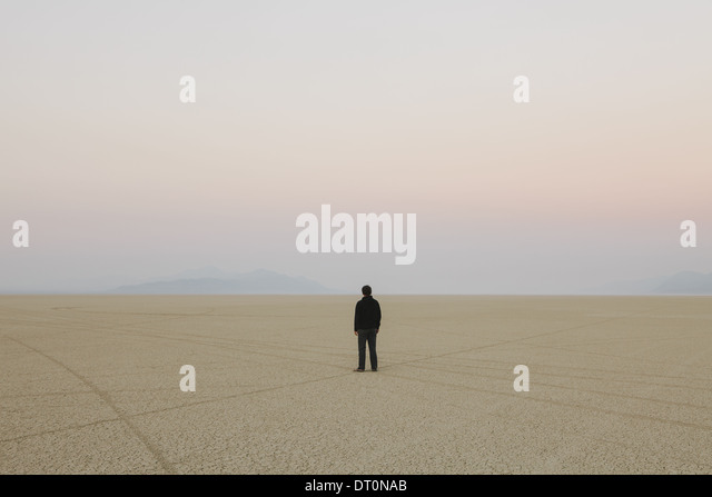 Black Rock Desert Nevada USA Man standing in vast desert landscape - Stock Image