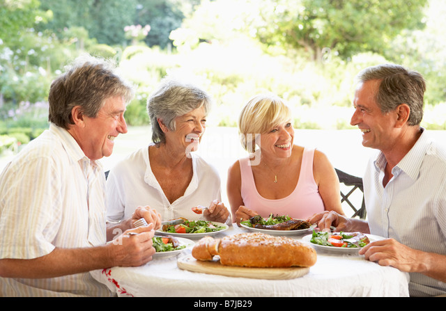 Friends Eating An Al Fresco Lunch - Stock Image