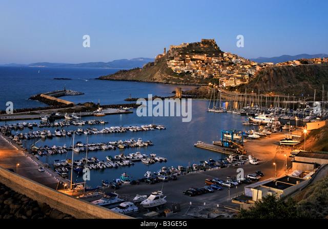 Italy Sardinia Castelsardo harbour at twilight - Stock Image