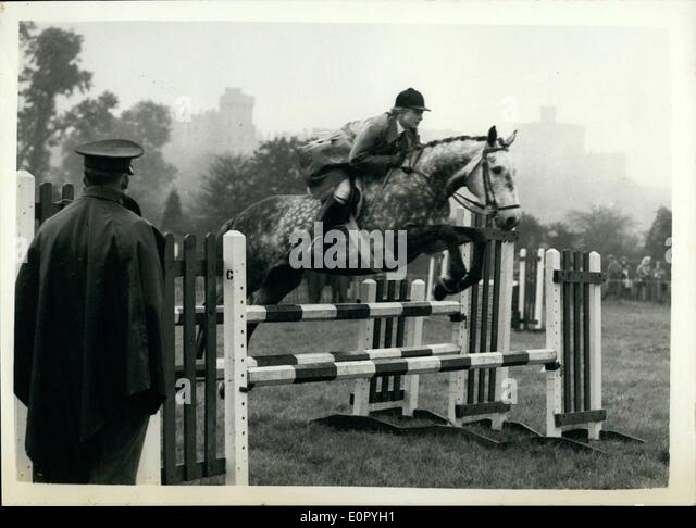 May 05, 1957 - Opening Of The Royal Windsor Horse Show Jumping in The Rain: The Royal Windsor Horse Show opened - Stock Image