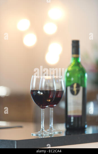 Two wine glasses and a bottle of wine - Stock Image