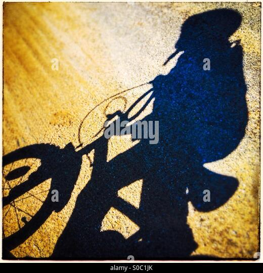 Boy ridding a bike - Stock Image