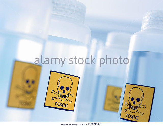 Bottles with toxic labels - Stock Image