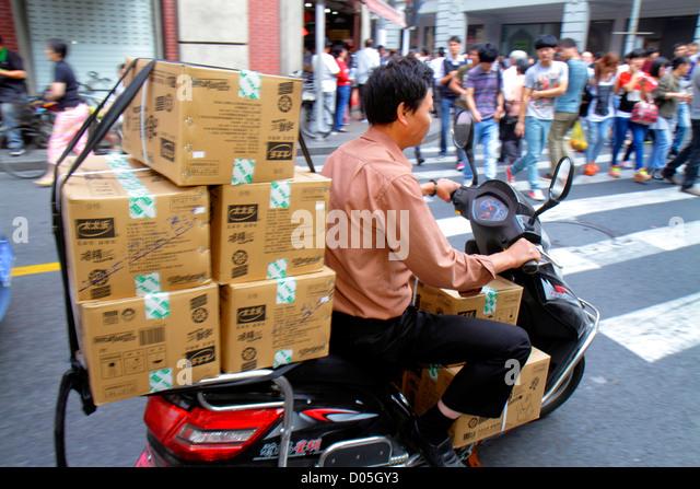 Shanghai China Huangpu District East Nanjing Road National Day Golden Week Asian man pedestrians street scene motor - Stock Image