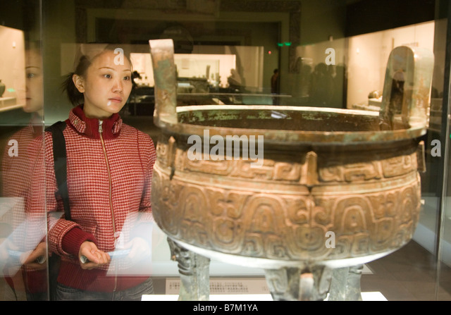 A girl perusing an exhibit at the Shaanxi Historical Museum a large and excellent museum in Xi an Shaanxi province - Stock Image